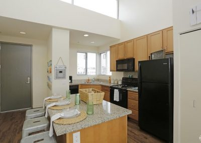 Kitchen and Island in an Apartment at Paseo Place