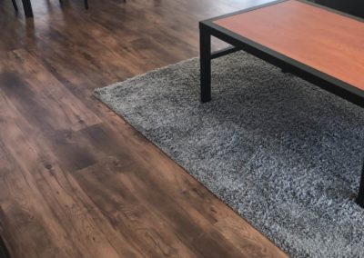 Wood Floor With a Rug in an Apartment at Paseo Place