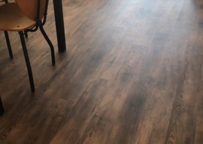 Wood Floor in a Living Room at Paseo Place's Apartments Near SDSU