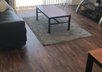 Newly Renovated Living Room Floor of an Apartment at Paseo Place